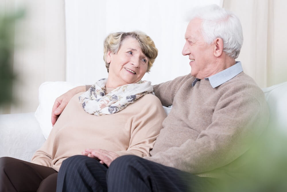elderly couple relaxing at home