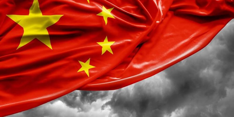 chinese flag and potential dark clouds